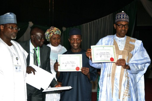 President-elect Buhari and VP elect, Osinbajo, display certificate of return.