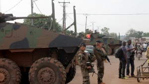 French soldiers stand near armoured personnel carriers on March 13, 2015 in Bangui, Central African Republic (AFP Photo/Pacome Pabandji)
