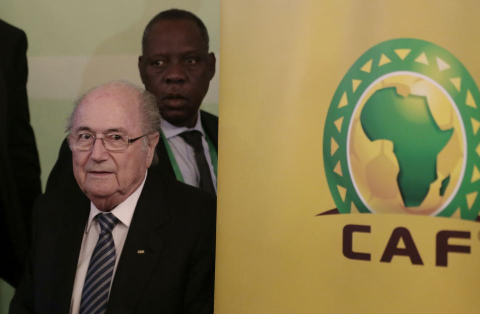 """FIFA President Sepp Blatter, left, and Confederation of African Football President Issa Hayatou, back, leave a press conference in Cairo, Egypt, Tuesday, April 7, 2015. Every one of Africa's 54 member countries will vote for Sepp Blatter in next month's FIFA presidential election, the continent's soccer boss said on Tuesday, referring to the 79-year-old Swiss as """"dear Sepp """". (AP Photo/Hassan Ammar)"""