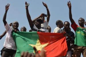 People celebrate in Ouagadougou on October 31, 2014 after Burkinese President Blaise Compaore announced that he was stepping down (AFP Photo/Issouf Sanogo)
