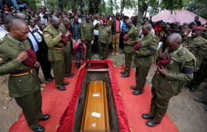 Kenya Police from the elite Recce Company squad pay their respects as the coffin is lowered into the grave at the funeral of Corporal Benard Kipkemoi Tonui, who was killed as he battled gunmen that attacked Garissa University, in the village of Cheleget in Bomet, April 11, 2015. Kenya has given the United Nations three months to remove a camp housing more than half a million Somali refugees, as part of a get-tough response to the killing of 148 people by Somali gunmen at a Kenyan university. REUTERS/Stringer TPX IMAGES OF THE DAY