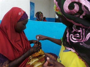 Photo: Kingsley Nfor Monde/IRIN A child receives the polio vaccine in the Minawao refugeee camp