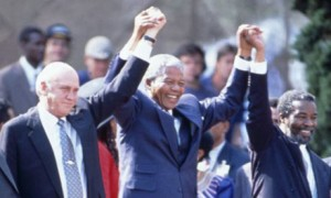 Nelson Mandela at his presidential inauguration with his deputies, FW de Klerk and Thabo Mbeki, what happened to the South African promise?