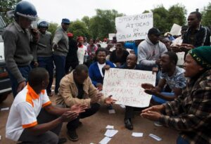 Zimbabwean citizens protest outside the South African Embassy in Harare, against a wave of violence against immigrants in parts of South Africa on April 17, 2015 (AFP Photo/Jekesai Njikizana)