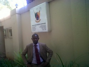 Solomon Amabo infront of Cameroon High Commission office in South Africa