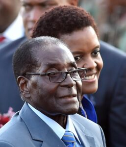 Zimbabwean president, Robert Mugabe, front, and his wife Grace, rear, arrive in Pretoria, South Africa Tuesday, April 7, 2015 for a state visit to the country. Mugabe will be in the country until Thursday and will meet with South African president Jacob Zuma Wednesday.(AP Photo)