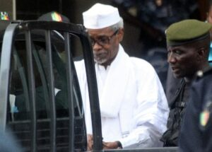 Former Chadian dictator Hissene Habre is escorted by military officers after being heard by a judge on July 2, 2013 in Dakar, Senegal (AFP Photo/)
