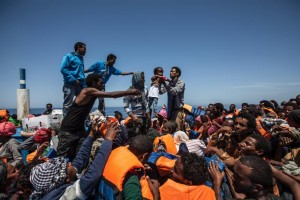 Picture taken on May 3, 2015 and released by the MOAS (Migrant Offshore Aid Station) shows migrants waiting aboard a wooden boat during a rescue operation off the coast of Sicily in the Mediterranean (AFP Photo/Jason Florio)