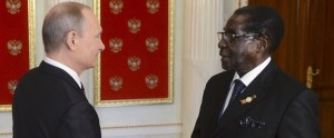 President Mugabe and Russia's President Vladmir Putin exchange greetings in Moscow yesterday. - Photograph:Zim Daily