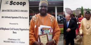"""The Director of AFRICAphonie, Mwalimu George Ngwane, receiving the """"2014 The Scoop Civil Society Organisation of the Year"""" award by The Scoop Media Group. May 3rd 2015 (World Press Freedom Day) in Kumba.  Under the distinguished patronage of the Turkish ambassador to Cameroon and attended by Senator Nfon V. Mukete and the Government Delegate to the Kumba City Council. Photo Hansel Media"""