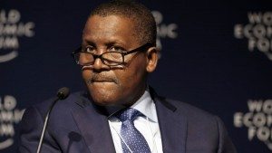 Aliko Dangote, billionaire and chief executive officer of Dangote Group, pauses during a session at the World Economic Forum in Davos, Switzerland, on Jan. 22, 2015. Photographer: Jason Alden/Bloomberg