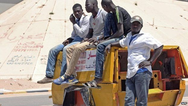 Migrants in Tripoli gather at points where contractors come to offer them jobs