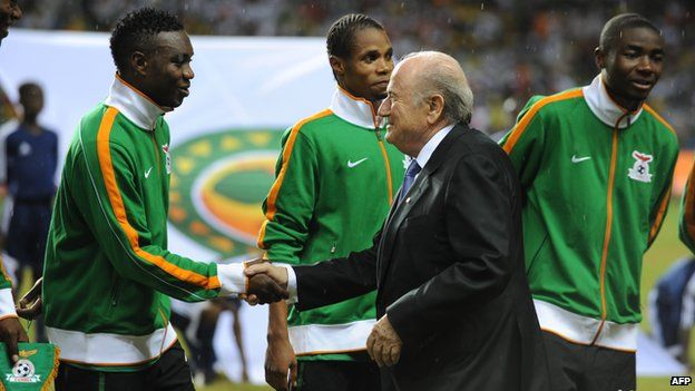 "Sepp Blatter (here with the Zambian team) ""feels Africa"", said one delegate"