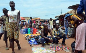 """People walk through the main market at """"Kilometre Five"""" in Bangui on May 18, 2015, where refugees, mostly Muslims, gathered during inter-relgious violence that wracked the Central African Republic in December 2013 (AFP Photo/Patrick Fort)"""