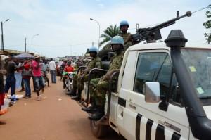 "UN Peacekeeping troops patrol the main market at ""Kilometre Five"" in Bangui on May 18, 2015 (AFP Photo/Patrick Fort)"