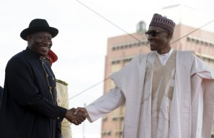 Former Nigerian president Goodluck Jonathan (left) shakes hands with his successor Mohammadu Buhari after handing over power during a ceremony at Eagles Square in Abuja, on May 29, 2015 (AFP Photo/Pius Utomi Ekpei)