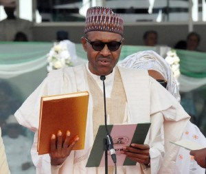 Nigerian President Mohammadu Buhari takes an oath during his inauguration at the Eagles Square in Abuja, on May 29, 2015 (AFP Photo/)