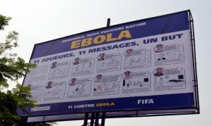 """A board bearing the """"11 against Ebola"""", a joint campaign between FIFA, the CAF and health experts, to raise awareness in the fight against Ebola on December 17, 2014 (AFP Photo/Zoom Dosso)"""