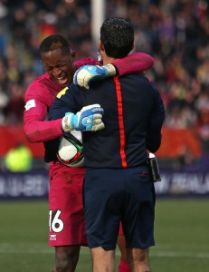 Goalie Djigui Diarra of Mali, left, embraces referee Cesar Arturo Ramos Palazuelos of Mexico as he celebrates their win over Germany in a penalty shoot out during their U20 soccer World Cup quarterfinal game in Christchurch, New Zealand, Sunday, June 14, 2015. Mali win on penalties 4 - 3. (AP Photo/Dianne Manson)