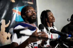 Fadel Barro (L), one of the leaders of Le Y'en a Marre, speaks at a press conference in Kinshasa in March. Three members of the Senegalese rap group were among 30 people detained while at a workshop in Kinshasa (AFP Photo/Federico Scoppa)