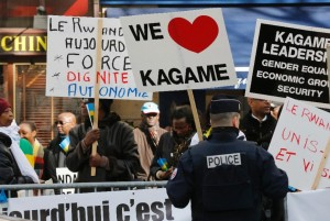 Supporters of Rwandan President Paul Kagame gather during a rally near the offices of UNESCO in Paris on February 27, 2015, where the president was attending a meeting (AFP Photo/Francois Guillot)
