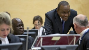 Kenya President Uhuru Kenyatta, second right, talks to his defense team when appearing before the International Criminal Court in The Hague, Netherlands, Oct. 8, 2014.