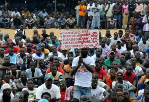 """People attend the first rally of the opposition National Coalition for Change on June 20, 2015 in the Yopougon district of Abidjan, with a sign reading """"Gbagbo yesterday, today, tomorrow, for ever"""", refering to former president Laurent Gbagbo (AFP Photo/Sia Kambou)"""