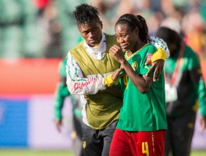 Cameroon's Yvonne Leuko (R) is comforted by teammate Yvonne Leuko following their 1-0 loss to China at the Women's World Cup, in Edmonton, Alberta on June 20, 2015 (AFP Photo/Geoff Robins)