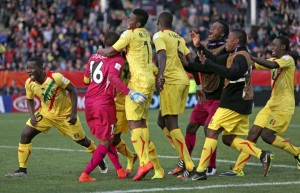 Mali teammates celebrate their win over Germany in a penalty shoot out during their U20 soccer World Cup quarterfinal game in Christchurch, New Zealand, Sunday, June 14, 2015. Mali win on penalties 4 - 3. (AP Photo/Dianne Manson)