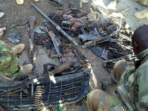 Nigerian soldiers show arms and ammunition recovered from Boko Haram Islamists during military operations in Dikwa on May 23, 2015 (AFP Photo/