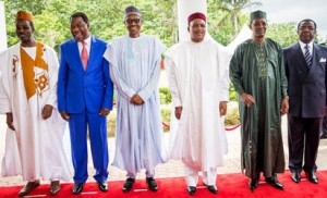 From left: Executive Secretary of Lake Chad Basin Commission, Sanusi Imran Abdullahi; President of Benin Republic, Thomas Boni Yayi; President Muhammadu Buhari; President of Niger Republic, Mahamadou Issoufou; President of Chad, Idriss Deby and President of Cameroon represented by Defence Minister of Cameroon, Edgar Alain Mebe Ngo'o after the Lake Chad Basin Commission meeting at the Presidential Wing of the Nnamdi Azikiwe International Airport in Abuja during a meeting to discuss strategies to fight Boko Haram