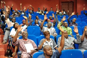"Members of Burkina Faso's interim parliament raise their hands on July 16, 2015 in Ouagadougou as they vote on a resolution asking the High Court to put deposed leader Blaise Compaore on trial for ""high treason"" and violating the constitution (AFP Photo/Ahmed Ouoba)"