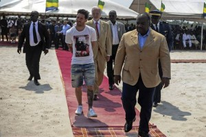 Happy holiday: Lionel Messi is given a tour during the start of construction of the Port-Gentil Stadium by the President of Gabon, Ali Bongo Ondimba