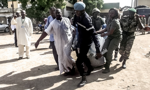 Security forces transport the remains of some of the eleven victims of a double blast in the northern Cameroonian city of Maroua.