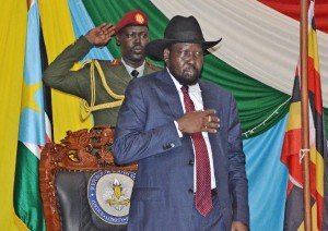South Sudan's President Salva Kiir (C) before signing peace agreement in Juba on August 26, 2015 (AFP Photo/Samir Bol)