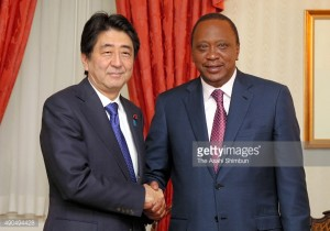 Japanese Prime Minister Shinzo Abe and Kenyan President Uhuru Kenyatta shake hands prior to their meeting
