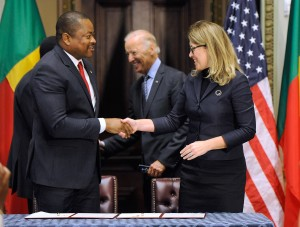Benin Minister of Finance Komi Koutche, left, and MCC CEO Dana J. Hyde, right, shake hands after signing the $375 million Benin Power Compact in the presence of Benin President Dr. Thomas Boni Yayi, not shown, and U.S. Vice President Joe Biden, center, Wednesday, Sept. 9, 2015, in Washington.