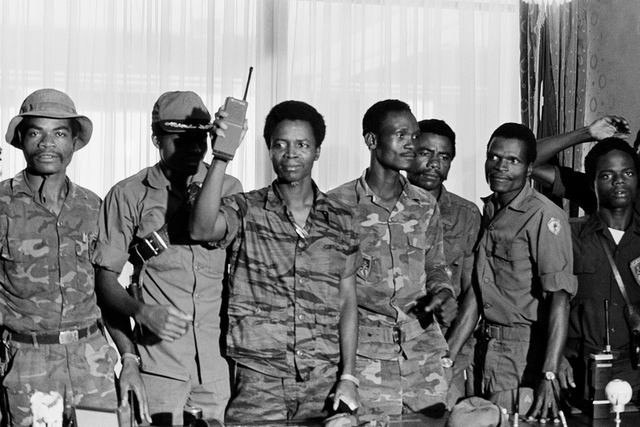 Former President Samuel K. Doe, holding a walkie-talkie, after the 1980 coup that toppled President William Tolbert Jr. Photograph by Sando Moore/AP.