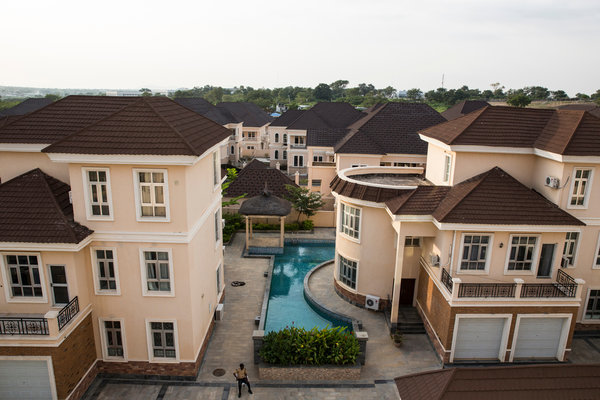 At Royal Choice, a private housing estate on the outskirts of Abuja, 20 mansions have been built but only two are occupied. Buyers have used estates like this one as investments and eagerly bought up property, often paying in cash. Credit Glenna Gordon for The New York Times