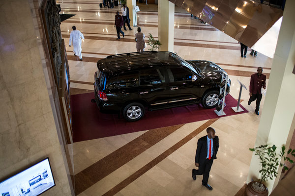 An armored car on display in the lobby of a Hilton hotel in Abuja. At many upscale hotels and businesses  in the capital, commerce has slowed this year, which many attribute to the government's crackdown on corruption. Credit Glenna Gordon for The New York Times