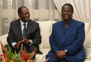 Ivorian President Alassane Ouattara (L) talsk to former President and the President of the Democratic Party of Cote d'Ivoire, Konan Bedie Henri, during a meeting in Abidjan, on October 27, 2015 (AFP Photo/Sia Kambou)