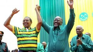 Tanzania's public works minister John Pombe Magufuli, right, celebrates with president Jakaya Kikwete, left, after the ruling party announced its presidential candidate, in Dodoma, Tanzania, Sunday, July 12, 2015. Tanzania's ruling party, which has been in power for five decades, has chosen public works minister John Pombe Magufuli as its presidential candidate, making him the favorite to replace current president Jakaya Kikwete in the upcoming October election. (AP Photo/Khalfan Said) (The Associated Press)