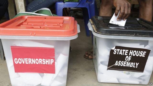 A man casts a ballot in Lagos, Nigeria, April 11, 2015.