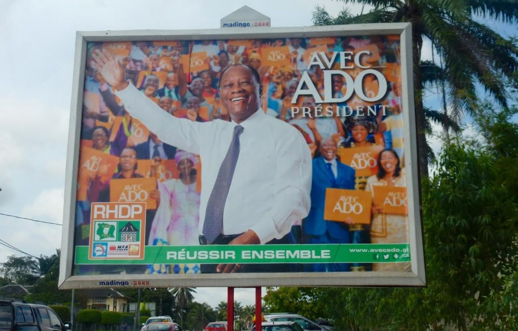 One of the many billboards in support of President Alassane Ouattara in Abidjan, Côte d'Ivoire. Photograph by Sophie Rosenberg.