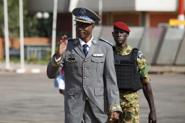 Burkina Faso's coup leader General Gilbert Diendere arrives at the airport to greet foreign heads of state in Ouagadougou, Burkina Faso, September 23, 2015.  REUTERS/Joe Penney