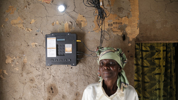 Elizabeth Mukwimba, an M-Power Off Grid Electric customer in Tanzania. With increased investment, cheaper products and innovative business models, solar is not only on the rise, but could transform the way the African continent is powered. Photo by: Russell Watkins / U.K. Department for International Development / CC BY