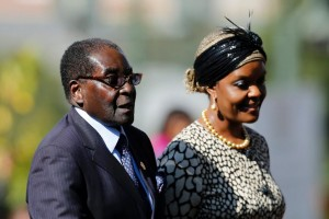 Zimbabwean President Robert Mugabe and his wife Grace arrive for a 2014 ceremony in Pretoria, South Africa (AFP Photo/Siphiwe Sibeko)