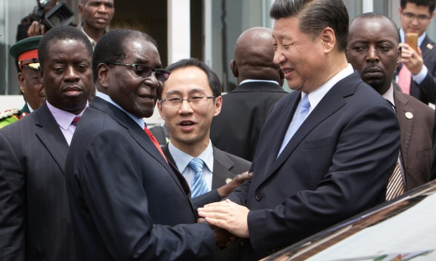 Robert Mugabe shakes hands with Xi Jinping as the Chinese president arrives in Harare