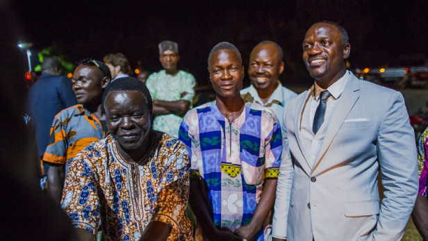 Senegalese-American singer Akon (right, in suit) during a visit in Pahou, Benin. Photo by: Akon Lighting Africa