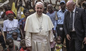 Pope Francis visits an internally displaced people camp in Bangui, Central African Republic. Photograph: Gianluigi Guercia/AFP/Getty Images